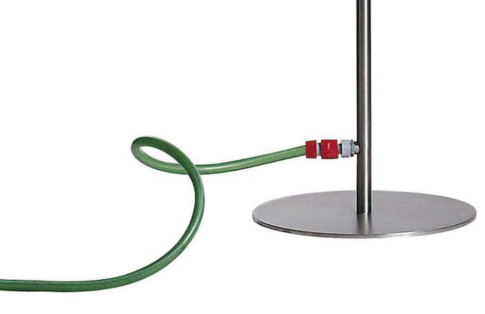 An outdoor shower with a hose connection. To supply water, a garden hose is connected to the base of the Screw Coro Outdoor Shower; £589 from Made in Design.