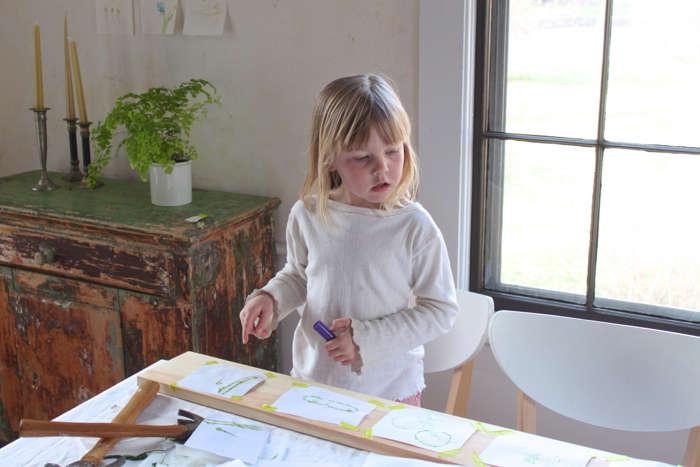 Solvi surveys her work.
