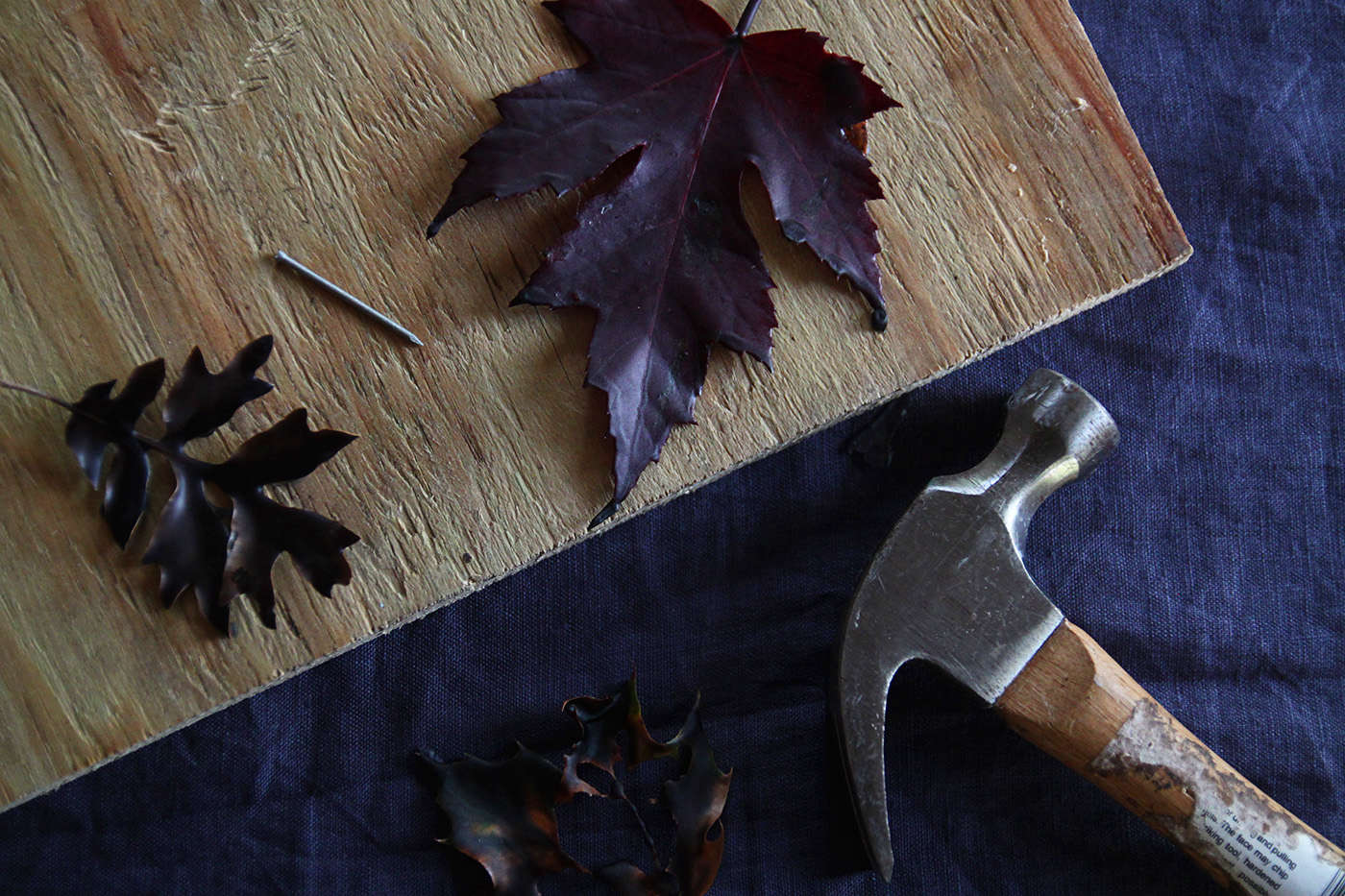 Halloween%20table%20with%20Black%20Leaves%2C%20making%20holes%2C%20by%20Justine%20Hand%20for%20Remodelista.jpg