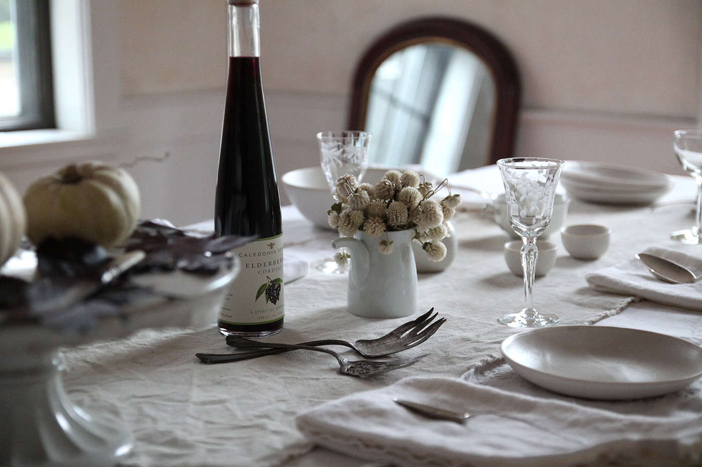 Haunted%20Table%20with%20Black%20Leaves%2C%20flowers%2C%20by%20Justine%20Hand%20for%20Remodelista
