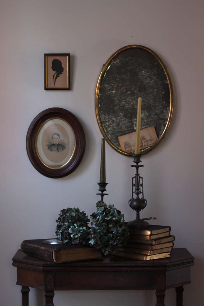 A gilded vignette conjures the feeling of faded grandeur.