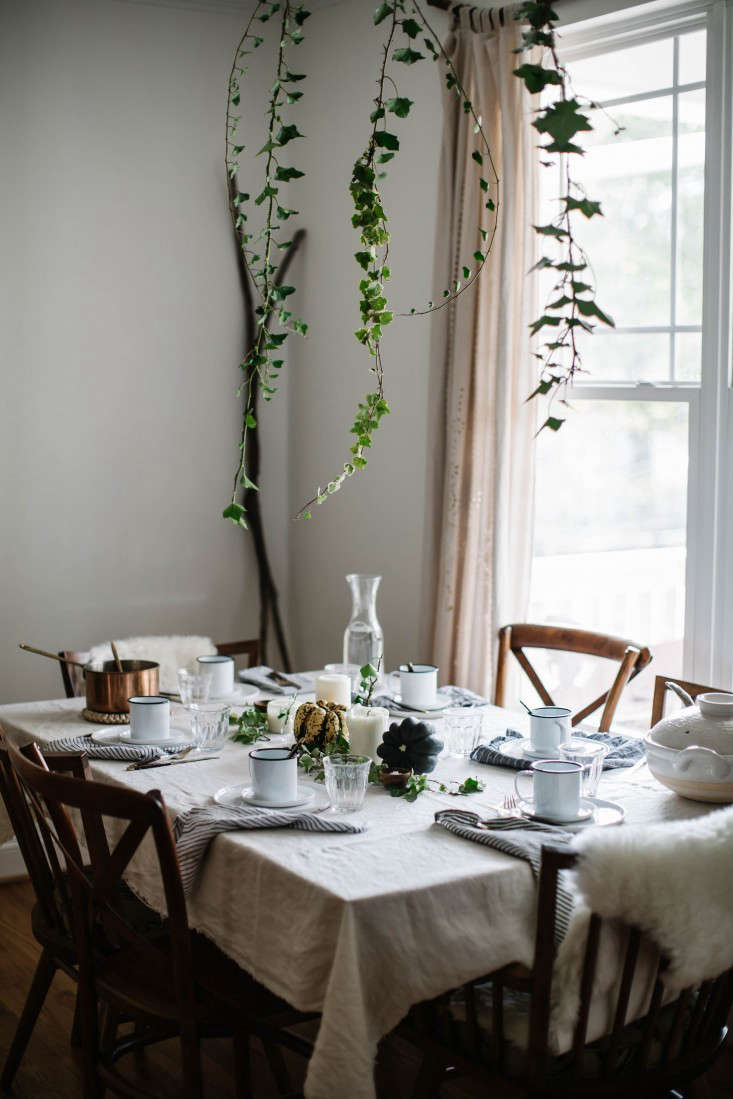 Local Milk blogger Beth Kirby created this clever hanging centerpiece with foraged vines. Photograph by Beth Kirby, from Thanksgiving on a Budget: 7 Tips for Tabletop Decor from Stylist Beth Kirby.