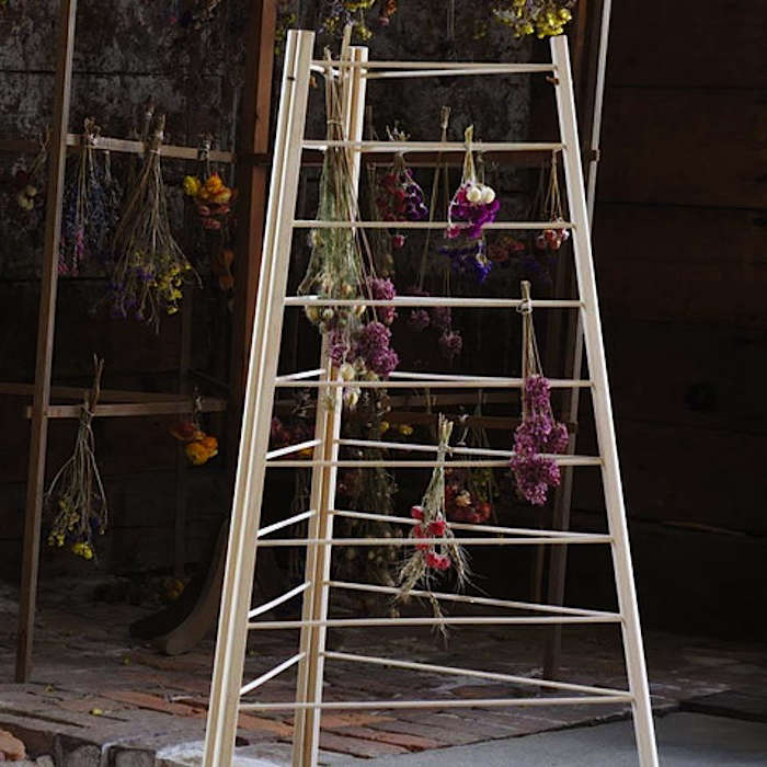 For drying herbs for cooking and medicinal use, the Shakers designed artful wooden drying racks (cousins to their ingenious clothes-drying racks). Buy aShaker Herb Drying Rack via the Canterbury Shaker Village, or hang a wooden rod in a dry place for similar effect.