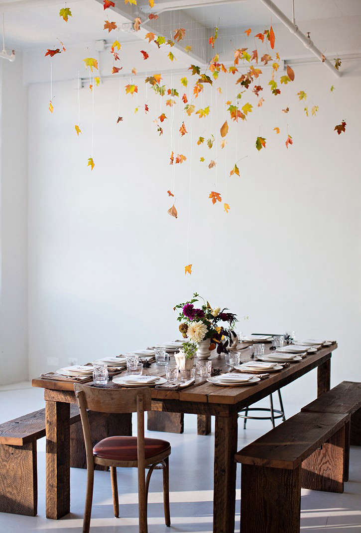 Leaves hung from clear fishing line in a dinner for the launch of Kinfolk Table hosted by Karen Mordechai of Sunday Suppers. Okay, this one is admittedly more time-consuming to fabricate, but think about all the money you&#8