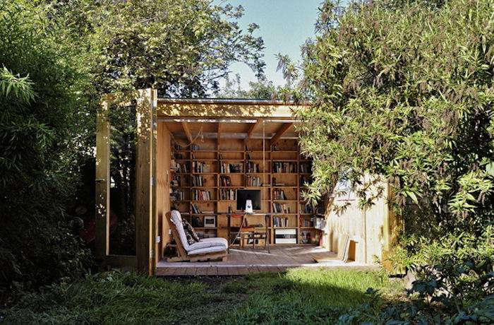 In London's north central Hackney, UK-based architecture firm Office Sian worked with a limited budget and the size constraints of a small backyard to design an elegant freestanding shed that functions as both a work space and a library, with retractable doors and a clear view of the garden. Photograph courtesy of Office Sian.