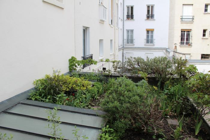 A glimpse onto the street in Paris' th arrondissement from architect NicolasSoulier and ceramist Cécile Daladier's rooftop.The garden was &#8