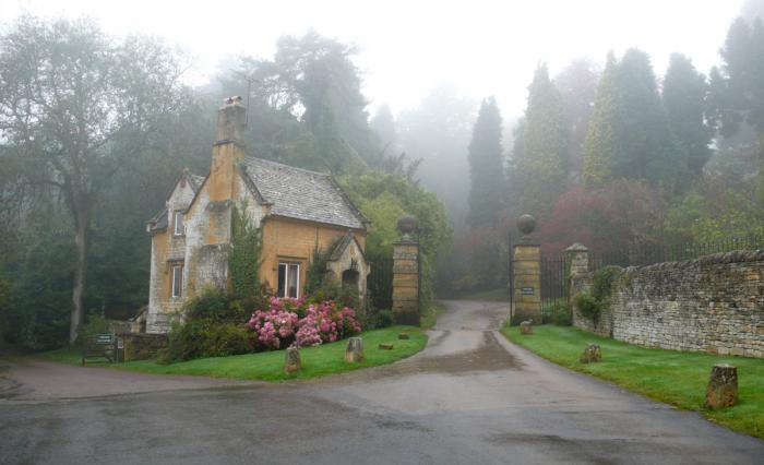 Before Lord Redesdale tackled the garden, he tackled the village. The church and houses were rebuilt to be more in keeping; a lodge is nestled by the gates here. For more foggy English gardens, see Season of Mist: Ben Pentreath&#8