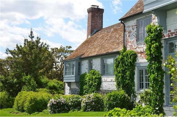 A facade softened by vines adds charm to the Old Sayville, Connecticut, the house Katharine Hepburn grew up in (and summered in most of her 97 years); the house is currently on the market for $loading=