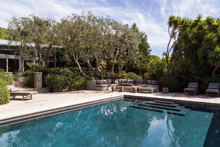 Enclosed by a wooden deck, a swimming pool and spa keep a low profile to blend in with the natural surroundings at actor Patrick Dempsey&#8