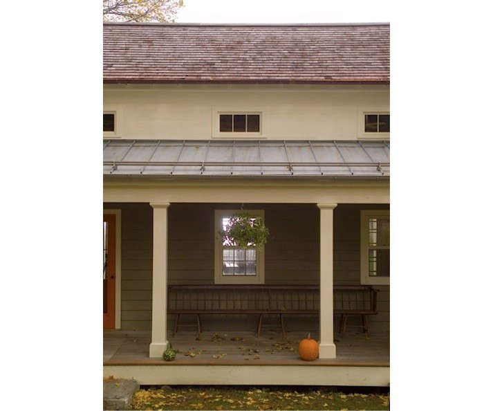 Metal roofing can be partnered with an existing shake or composite roof. In this example, the porch&#8