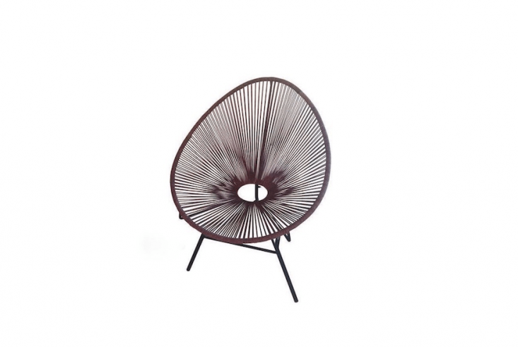From Roost, an Ellipse Acapulco Chair &#8\2\20;updates a vintage classic: with cotton cord and a dark iron base. It is available in three colors (Shown L to R: Indigo, Chocolate, and Natural) and is \$300 from Modish.