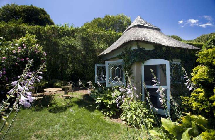 At Grey Gardens, hostas bloom along the facade of a garden folly.