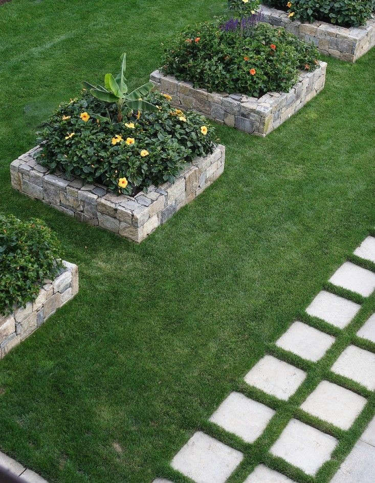 In Connecticut garden landscape architect Janice Parker created a procession of raised beds, a row of &#8\2\20;five strong planters spaced so the very ugly manhole covers in between them, which are for drain-out and maintenance on the coast and can&#8\2\17;t be grassed over, can&#8\2\17;t be seen,&#8\2\2\1; she says. For more of this garden, see Landscape Architect Visit: A Cottage Garden on the Connecticut Coast.