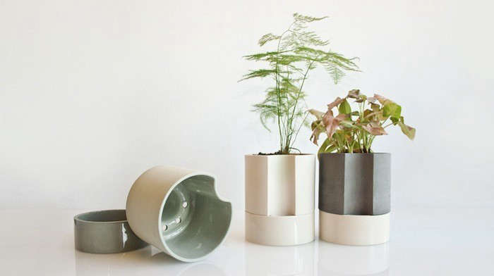 A Tall Self Watering Planter by Chromo has an indented channel on one side of the pot to make it easy to pour water into the planter&#8