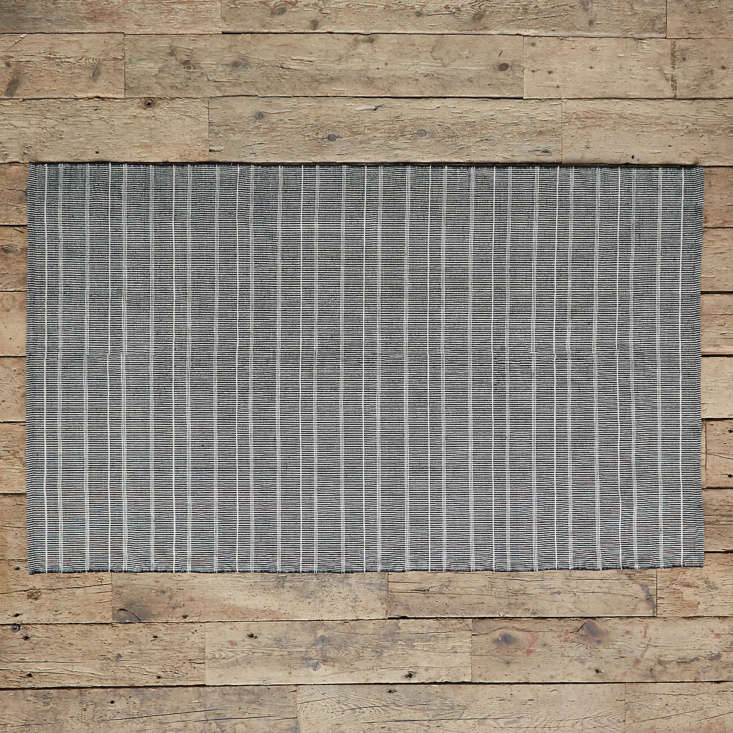Made of recycled PET fibers, the Colorblock Stripe Rug comes in three colors: black (shown), navy, and gray. Prices range from $9