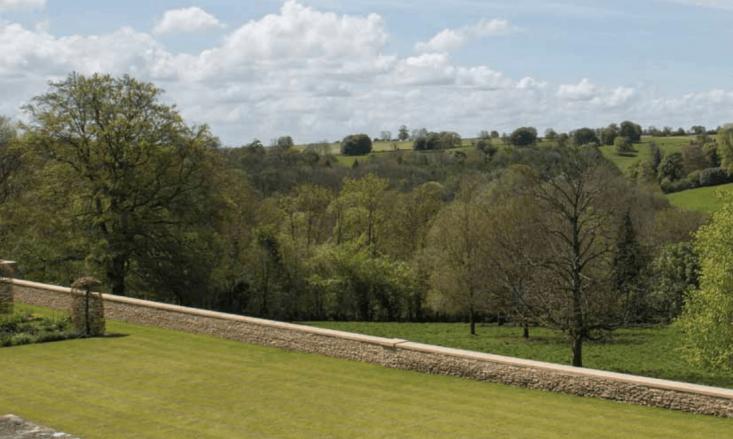 Duntisbourne house stone wall for sale Savills