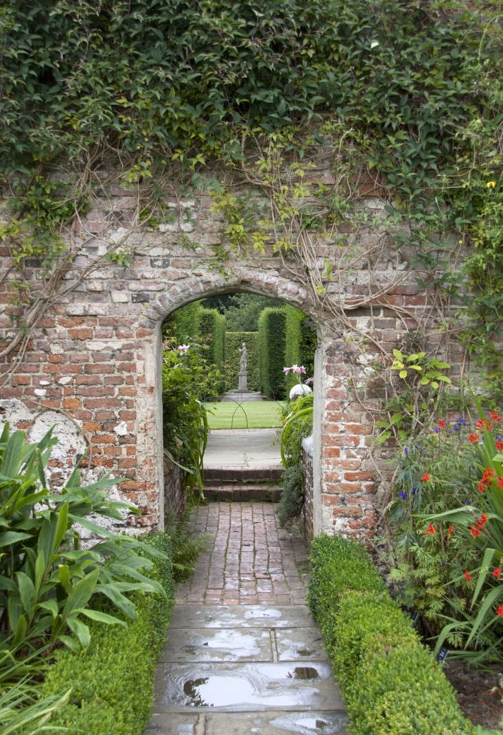 A dramatic entrance to a garden room at Sissinghurst Castle. Photograph by Tony Hisgett via Wikimedia. For more, see  Garden Ideas to Steal from Vita Sackville-West at Sissinghurst Castle.