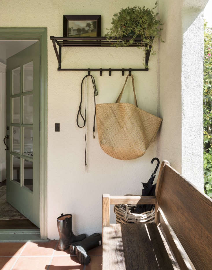 On my covered front porch, I corral hats, coats, shopping bags, and dog leashes with a blackPortis Hat Rack from Ikea; $.99. Photograph by Matthew Williams.