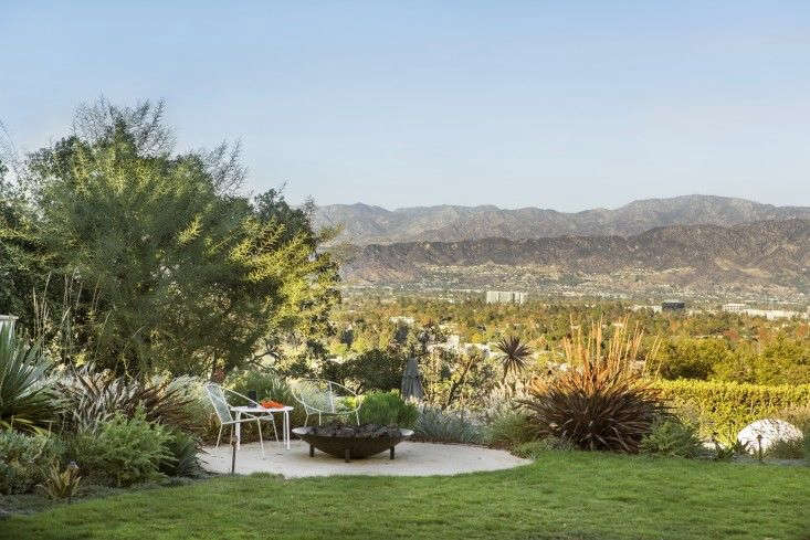 LA-based designer Judy Kameon created a decomposed granite pad to surround a fire pit, creating a patio seating area in a Studio City garden. Photograph by Laure Joliet. For more, see Landscape Design:  Tips for Adding a Fire Pit, from Judy Kameon.