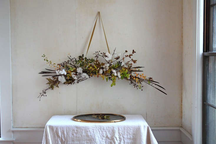 A gorgeous botanical arrangement made by Justine that can be kept on display through winter, it consists of store-bought cotton branches, millet, and pear branches. Photograph by Justine Hand for Gardenista, from DIY: A Winter White Holiday Bough.