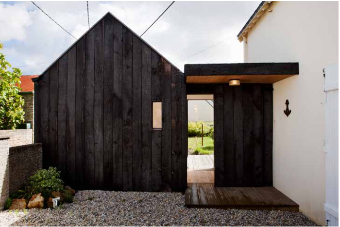On the coast of Brittany, architects Lucie Niney and Thibault Marca of Paris-based NeM Architectescreated a dark addition for a white vacation cottage. Photograph courtesy ofNeM Architectes. For more, see Before & After: A Charred Wood Cottage on a $45K Budget.