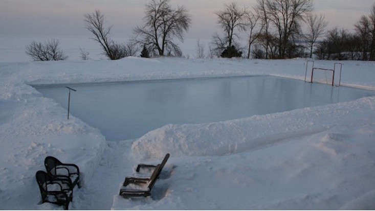 Photograph via Iron Sleek, which designs and sells outdoor ice rinks and sport court enclosures.