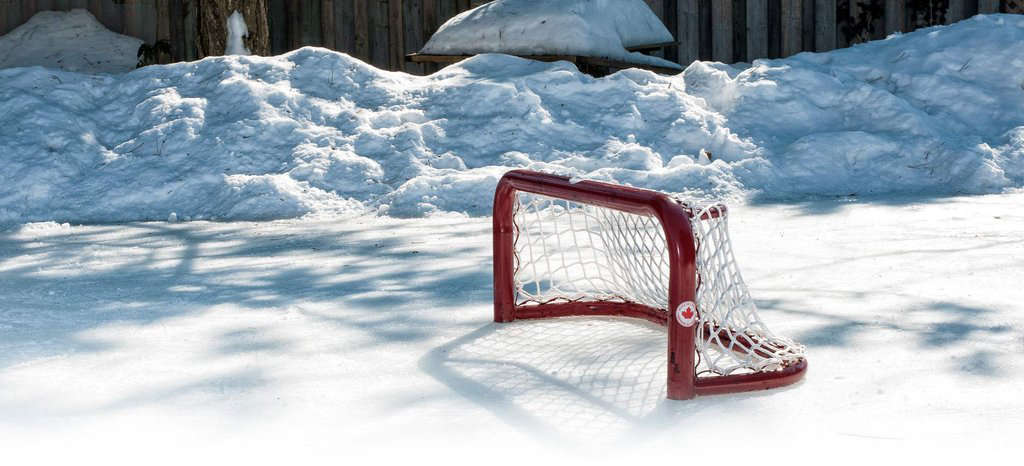 Photograph via Rink Master, which sells Rink Kits, Rink Liners, and Pond Hockey Nets.
