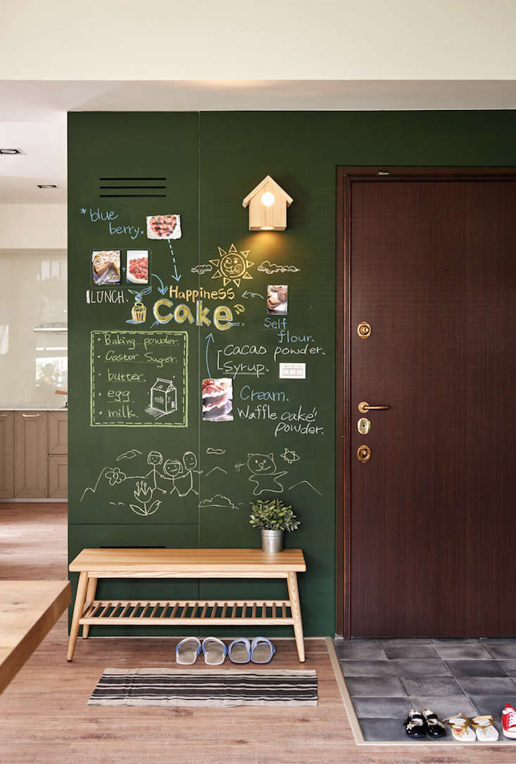 A chalkboard wall in the entryway is painted green (instead of a traditional black) to evoke nature.
