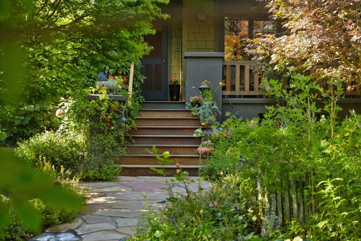 "The walk from the front gate to the stoop is only about 30 feet, but on the way you go past so much—a hydrangea grove, lemon trees, fragrant roses, Japanese maples, columbine, wisteria, herbs—""that it can take days to get there if you stop to smell everything."