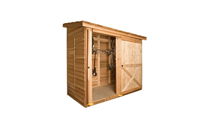 A DIY Cedar Shed Bayside Kit is customizable and comes with such options as a Dutch door, a fixed window, and a sliding door. The kit comes with pre-cut wood wall panels, hardware, a pre-shingled roof, and step-by-step instructions for assembly (no cutting necessary). It is \$\1,959 from Cedar Shed.