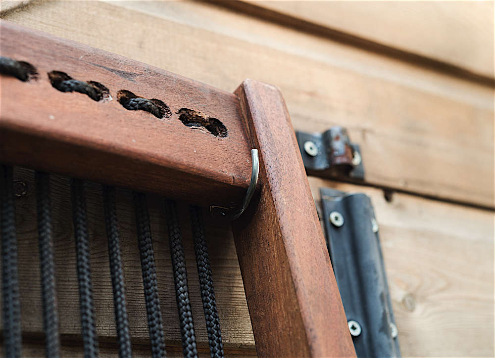 A detail of how the chaise hangs from the shed.