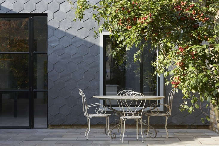 The thin legs on the wrought-iron chairs pose no problems on this patio with pavers. Photograph by Hufton & Crow for Gundry & Ducker, fromSteal This Look: A House With Slate Shingle Siding.