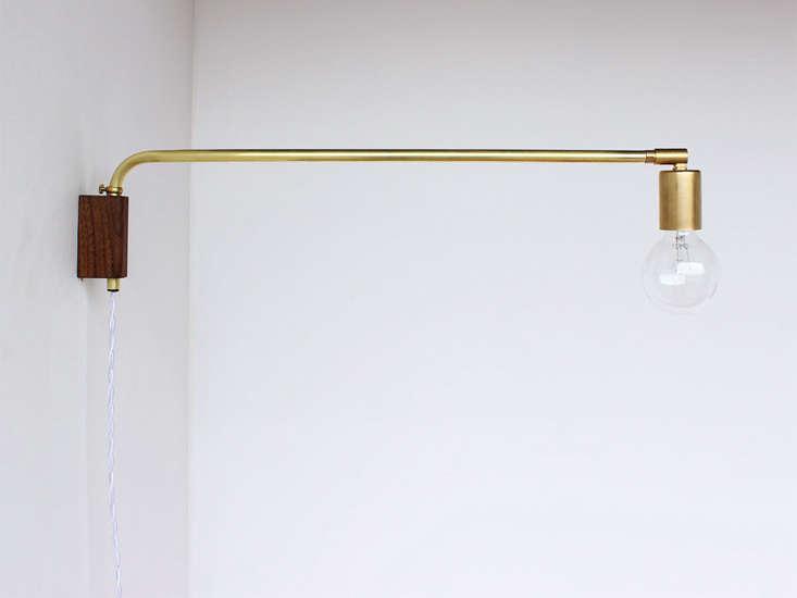 onefortythree-brass-swing-lamp-remodelista