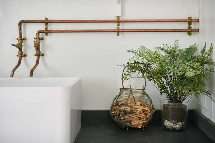 This week&#8\2\17;s Remodeling \10\1 post is in praise of wall-mounted faucets (and lacy ferns to to distract the eye from heavy, exposed plumbing).