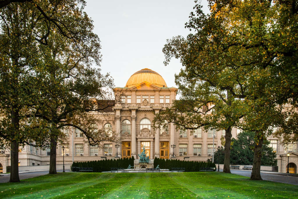 193,The dome of the Library building glows gold during an early autumn sunset