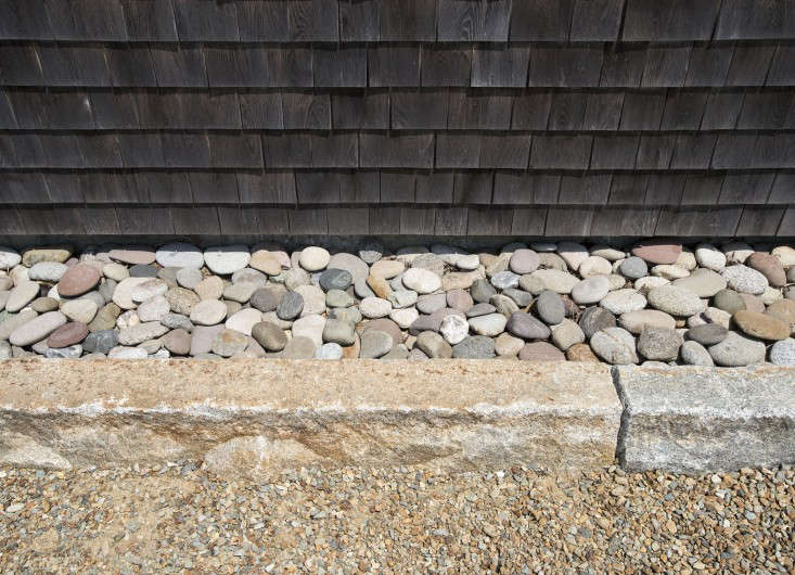 A stone curb keeps the pebbles from wandering.