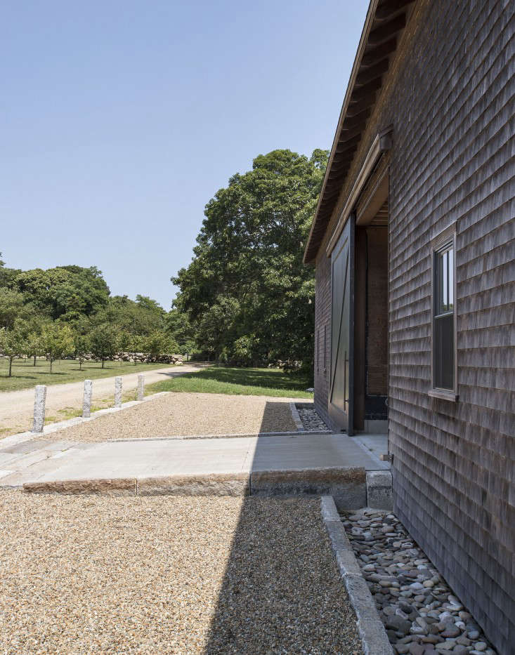 A French drain is installed around the perimeter of a barn on Martha&#8\2\17;s Vineyard.