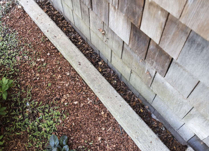 An unobtrusive perimeter drain runs alongside the foundation of a house in Mill Valley, California.