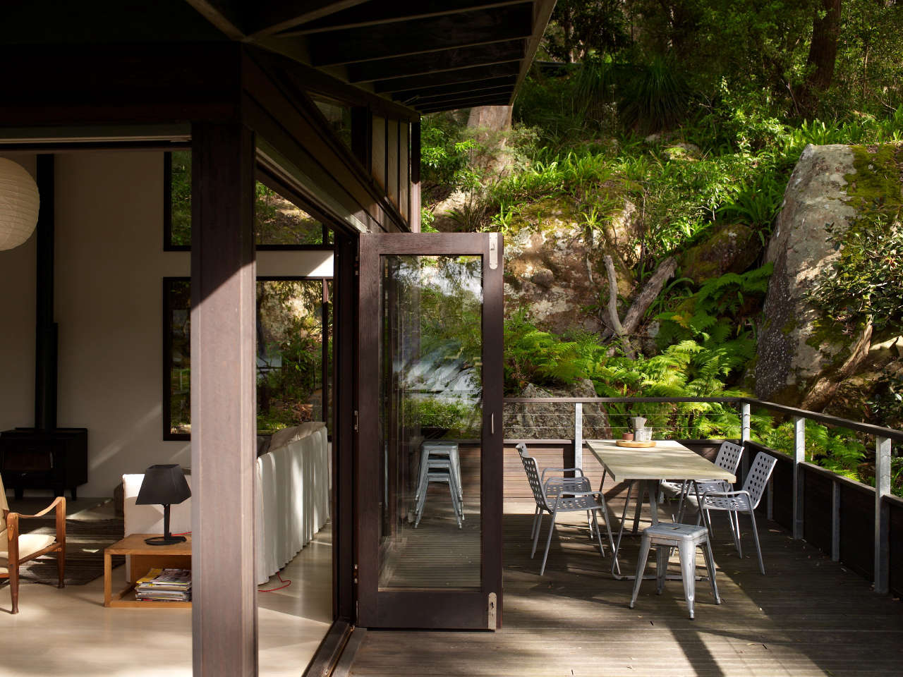 Dangar-Island-Rental-gracy-facade-deck-wire-railing-outdoor-dining-french-door-tolix-stool-gardenista