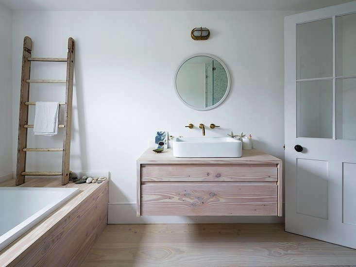 Pale wood plus ocean-washed stones equals a Scandi, summery bathroom. Photograph courtesy of Rory Gardiner, from Steal This Look: A London Bathroom Clad in Dinesen Wood.