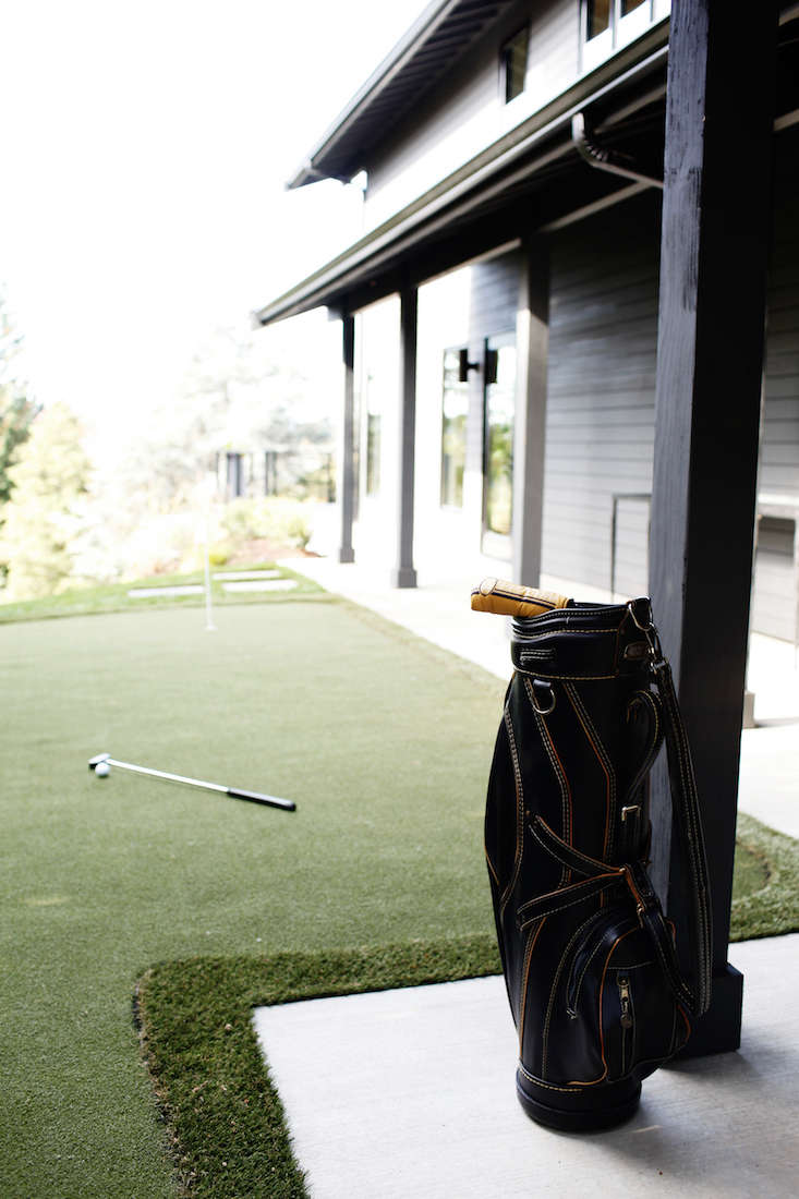A Seattle homeowner spent seven years traveling the world as a professional golfer; a putting green was a must. The green's ForeverLawn artificial grass is usable year-round. Photograph courtesy of Belathée Photography.