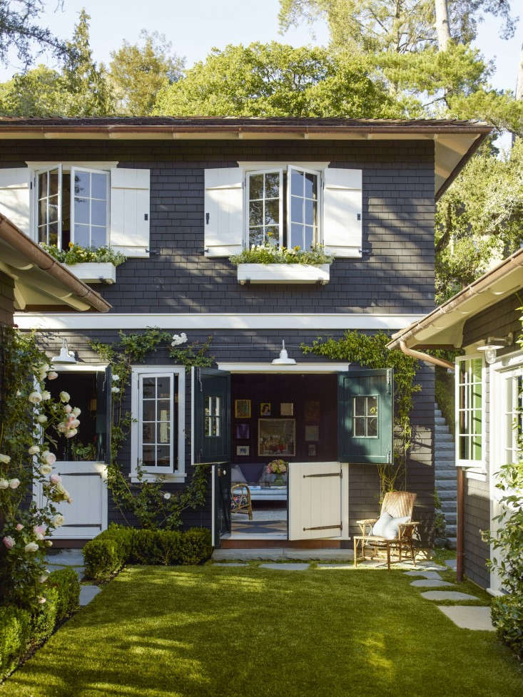 Dutch doors and barn-inspired shutters strike a farmhouse chord at a summer-camp turned family home in Mill Valley, California. See more in Garden Visit: Landscaping a Live-In Summer Camp. Photograph by Eric Piasecki, courtesy of OTTO.