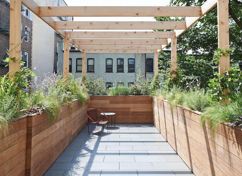 Mabbott Seidel Architecture in New York designed a terrace above the backyard of a Park Slope, Brooklyn home. It has a border of ipe wood planters tall enough to act as privacy barriers and a cedar pergola overhead that will eventually be covered by vines and climbers.