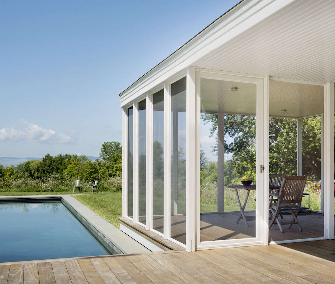 For the enclosed outdoor room, the architects had custom frames constructed using standard screening material. It&#8