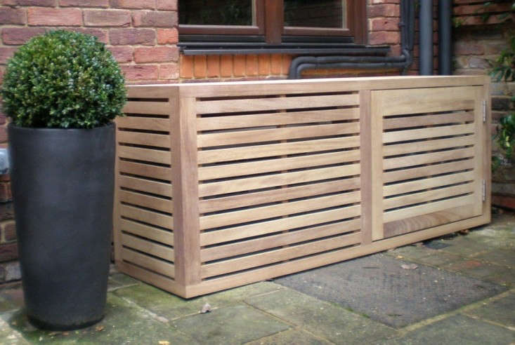 UK-based Garden Trellis builds custom Aircon Covers with slatted panels and a hinged door for access; for more information and pricing, see Garden Trellis. Photograph via Garden Trellis.