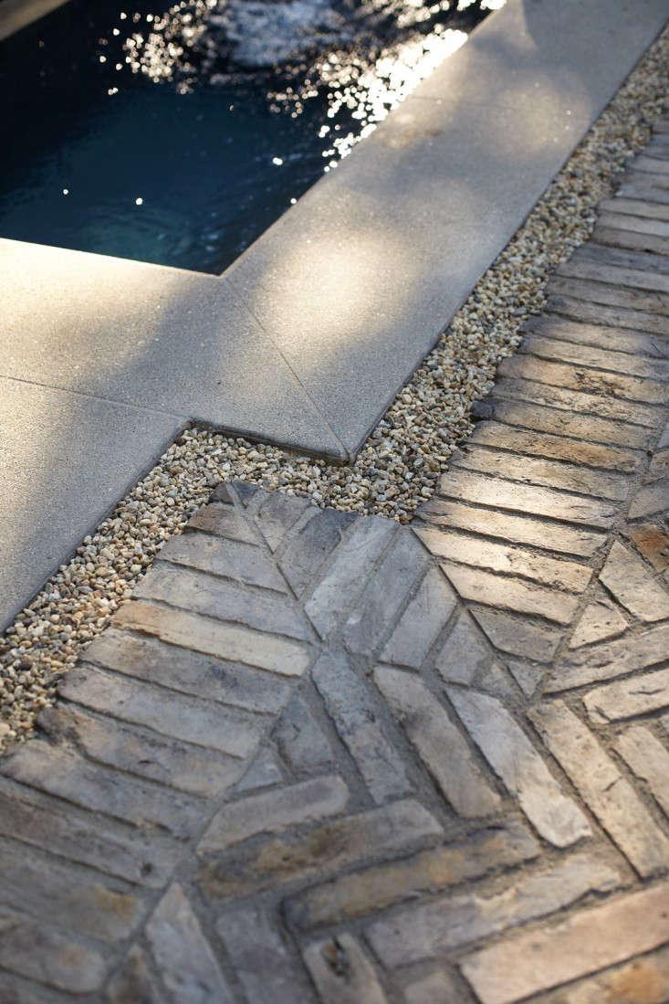 herringbone-brick-pavers-gravel-drainage-pools-gardenista