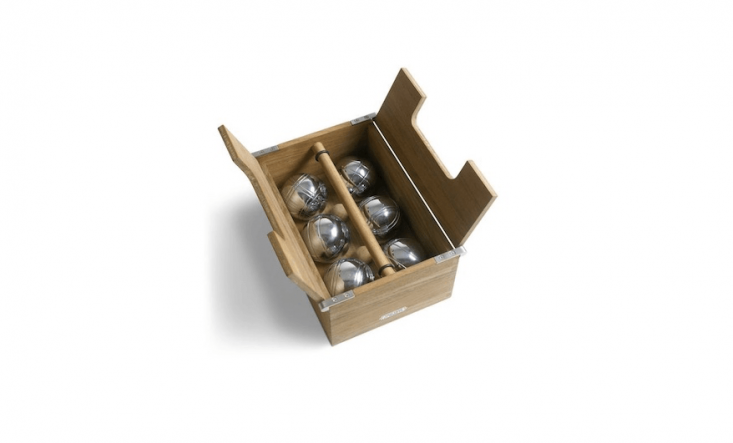 An Akiko Petanque Set from Skagerak comes with six steel balls and two teak target balls in a wood and steel box with handles; currently on sale for $75 at goop.