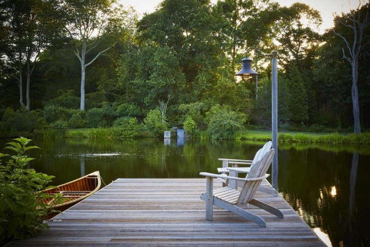 scott-mitchell-bridgehampton-landscape-garden-dock-adirondack-chairs-kayak-gardenista