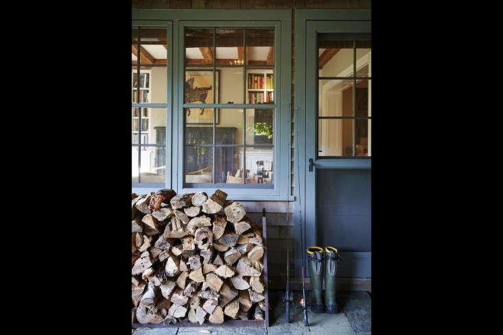 scott-mitchell-bridgehampton-landscape-garden-woodpile-porch-screened-door-boots-gardenista