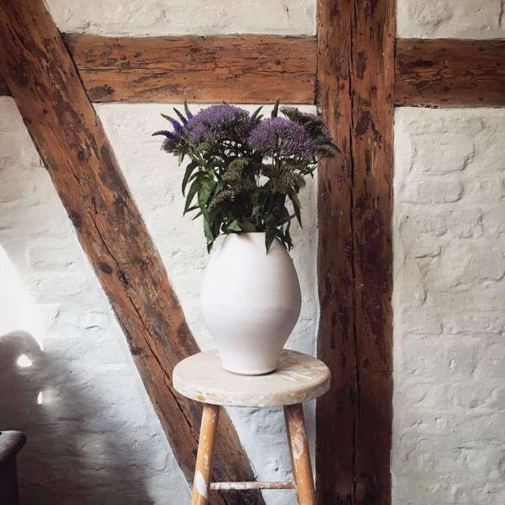 tortus-studio-vase-purple-flowers-brick-wall-copenhagen-gardenista